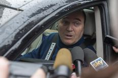 Former French racing driver Philippe Streiff speaks to journalists as he leaves the CHU hospital emergency unit in Grenoble, French Alps, where seven-times former Formula One world champion Michael Schumacher is hospitalized January 3, 2014. REUTERS/Emmanuel Foudrot