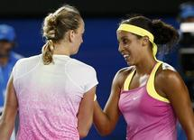 Madison Keys (R) of the U.S. shakes hands with Petra Kvitova of the Czech Republic after defeating her in their women's singles third round match at the Australian Open 2015 tennis tournament in Melbourne January 24, 2015. REUTERS/Thomas Peter