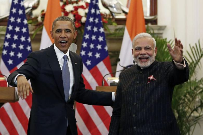 U.S. President Barack Obama stands next to Indian Prime Minister Narendra Modi (R) waving as they leave after giving their opening statement at Hyderabad House in New Delhi January 25, 2015. REUTERS/Adnan Abidi