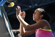 Madison Keys of the U.S. signs autographs after defeating compatriate Madison Brengle to win their women's singles fourth round match at the Australian Open 2015 tennis tournament in Melbourne January 26, 2015. REUTERS/Thomas Peter
