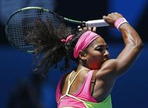Serena Williams of the U.S. hits a return to Dominika Cibulkova of Slovakia during their women's singles quarter-final match at the Australian Open 2015 tennis tournament in Melbourne January 28, 2015. REUTERS/Athit Perawongmetha