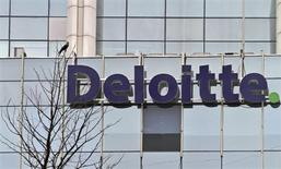 The Deloitte Company logo is seen on a commercial tower at Gurgaon, on the outskirts of New Delhi August 9, 2012. T REUTERS/Parivartan Sharma