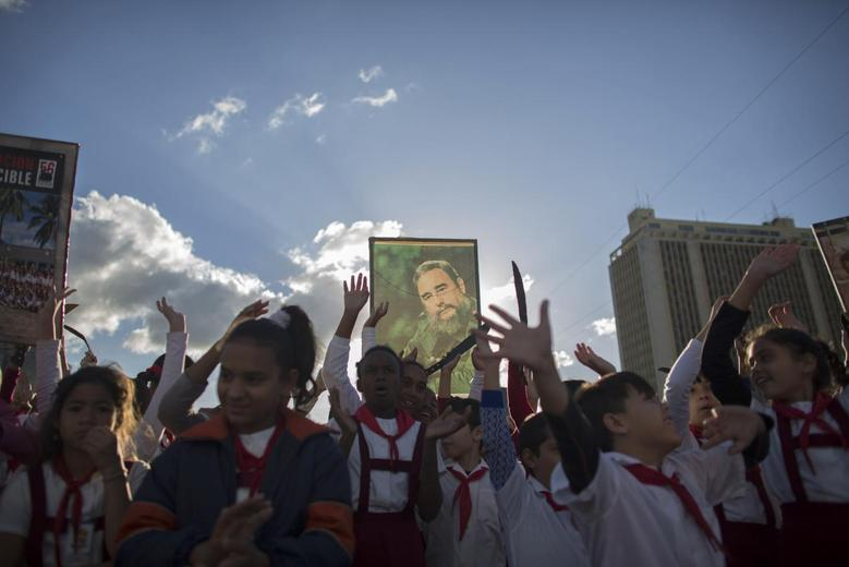 A student holds up a photograph of Cuba's former President Fidel Castro at the memorial of Jose Marti on Revolution Square in Havana January 28, 2015.  REUTERS/Alexandre Meneghini