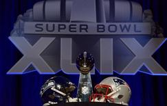 Jan 30, 2015; Phoenix, AZ, USA; A general view of the Vince Lombardi Trophy and helmets for the Seattle Seahawks and New England Patriots during a press conference for Super Bowl XLIX at Phoenix Convention Center. Mandatory Credit: Kirby Lee-USA TODAY Sports