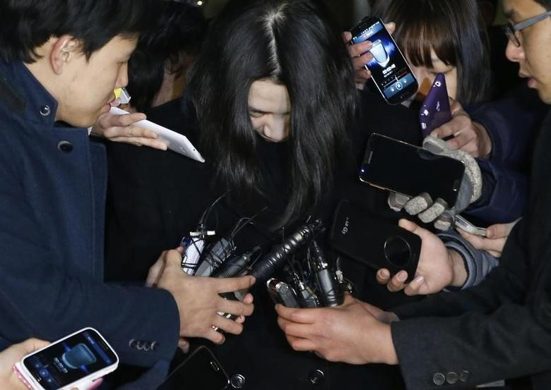 Cho Hyun-ah (C), also known as Heather Cho, daughter of chairman of Korean Air Lines, Cho Yang-ho, is surrounded by media as she leaves for a detention facility after a court ordered her to be detained, at the Seoul Western District Prosecutor?s office December 30, 2014. REUTERS/Kim Hong-Ji