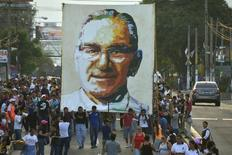 People carry a picture of late Archbishop Oscar Arnulfo Romero in San Salvador in this file photo taken on March 22, 2014. REUTERS/Jessica Orellana