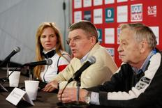 IOC president Thomas Bach (middle) speaks during a press conference  prior to the women's Super G in the FIS alpine skiing world championships at Raptor Racecourse. Mandatory Credit: Jeff Swinger-USA TODAY Sports