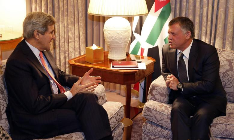 U.S. Secretary of State John Kerry sits in a meeting with Jordan's King Abdullah at the Four Seasons Hotel in the Georgetown neighborhood of Washington February 3, 2015.      REUTERS/Larry Downing