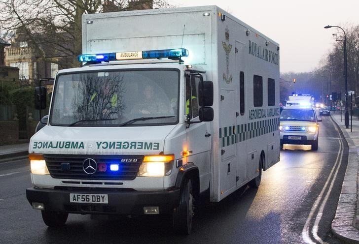 A convoy carrying a female Ebola patient arrives at the Royal Free Hospital in London December 30, 2014. REUTERS/Neil Hall/Files