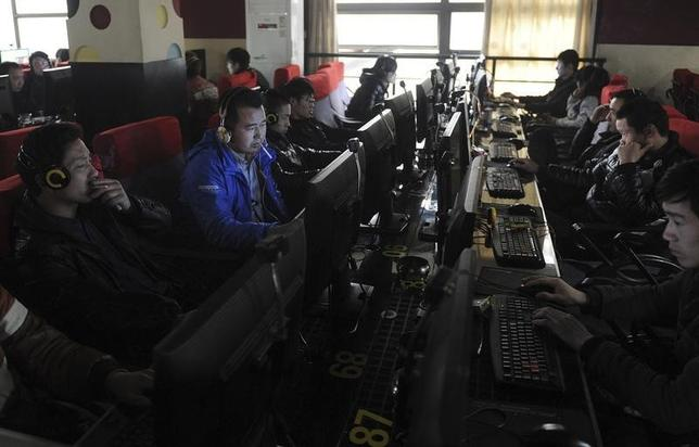 Customers use computers at an internet cafe in Hefei, Anhui province March 16, 2012. REUTERS/Stringer/Files