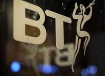 A BT logo is seen on the door of a telephone box in Manchester, northern England January 30, 2015.  REUTERS/Phil Noble