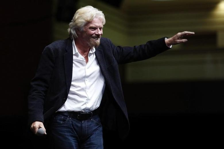 Entrepreneur Richard Branson waves to the audience during the World Business Forum Mexico 2014 in Mexico City October 23, 2014. REUTERS/Bernardo Montoya