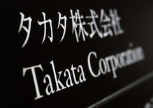 Takata Corp's company plate is seen at an entrance of the building where the Takata Corp headquarters is located in Tokyo December 9, 2014. REUTERS/Yuya Shino