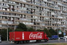 A truck transports bottles from the Coca-Cola company on the outskirts of Moscow, August 6, 2014. REUTERS/Maxim Shemetov