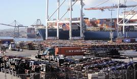 Thousands of cargo carriers sit idle as a ship is unloaded at the Port of Los Angeles October 27, 2014. REUTERS/Bob Riha Jr.