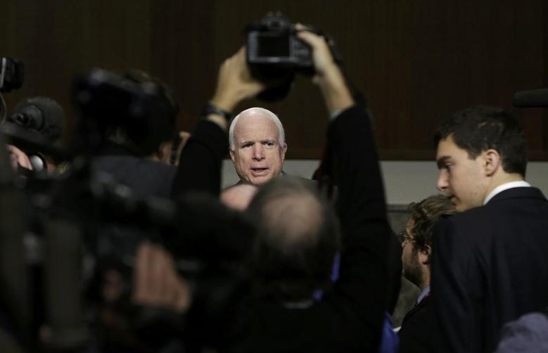 Senate Armed Services Committee Chairman John McCain (R-AZ) talks to the media during a break in a confirmation hearing for Ashton Carter, U.S. President Barack Obama's nominee to be secretary of defense,  on Capitol Hill in Washington, February 4, 2015. REUTERS/Gary Cameron