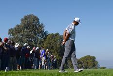 Feb 5, 2015; La Jolla, CA, USA; Tiger Woods reaches for his back after his drive on the 15th during the first round of the Farmers Insurance Open golf tournament at Torrey Pines Municipal Golf Course - South Co. Mandatory Credit: Jake Roth-USA TODAY Sports