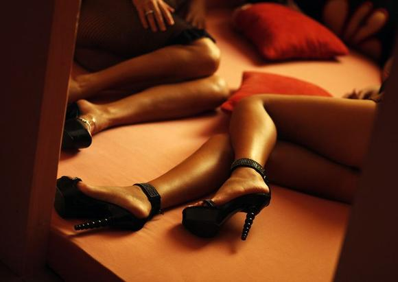 Romanian prostitutes pose in the brothel ''Pussy Club'' in Schoenefeld in this April 15, 2009 file photo. REUTERS/Hannibal Hanschke/Files