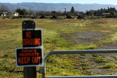 Signs are seen at an entrance to a field on land owned by the 250-member Pinoleville Pomo Nation in Ukiah, California January 23, 2015.  REUTERS/Robert Galbraith