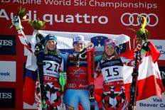 Feb 9, 2015; Beaver Creek, CO, USA; Nicole Hosp of Austria (left) , Tina Maze of Slovenia (middle) and Michaela Kirschgasser of Austria (right) celebrate on the podium at the flower ceremony after the women's alpine combined in the FIS alpine skiing world championships at Raptor Racecourse. Mandatory Credit: Jeff Swinger-USA TODAY Sports