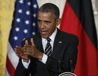 Президент США Барак Обама на совместной пресс-конференции с канцлером Германии Ангелой Меркель в Вашингтоне. 9 февраля 2015 года. Президент США Барак Обама сказал в понедельник, что Соединенные Штаты и их европейские союзники по-прежнему привержены дипломатическому урегулированию разногласий с Россией из-за кризиса на Украине, но готовы усилить изоляцию Москвы. REUTERS/Kevin Lamarque