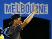 Lleyton Hewitt of Australia waves to the crowd after losing to Benjamin Becker of Germany in their men's singles second round match at the Australian Open 2015 tennis tournament in Melbourne January 22, 2015. REUTERS/Issei Kato