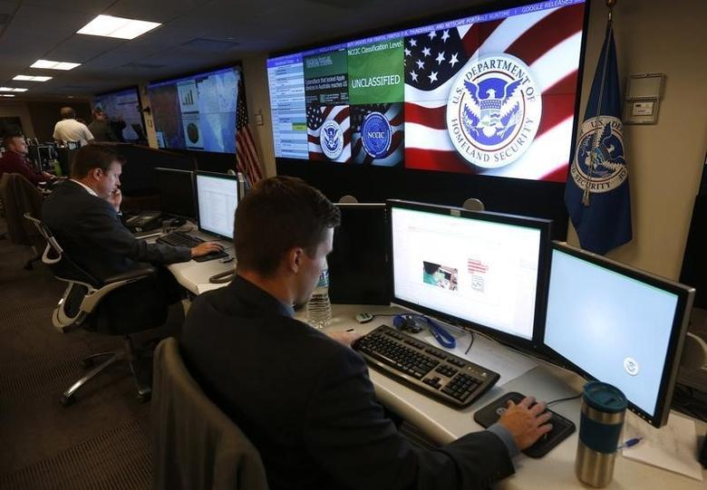 U.S. Department of Homeland Security employees work during a guided media tour inside the National Cybersecurity and Communications Integration Center in Arlington, Virginia in this file photo taken on June 26, 2014. REUTERS/Kevin Lamarque