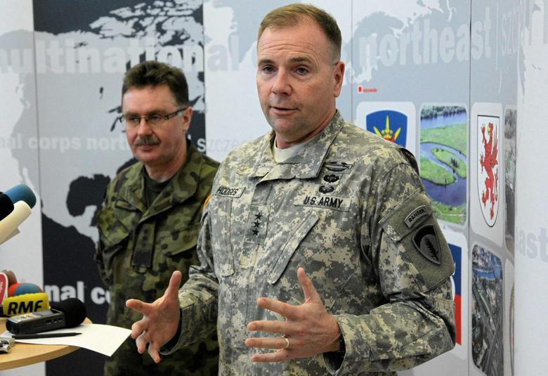 U.S. Army Europe commander Ben Hodges speaks as Polish general Boguslaw Samol stands during news conference during a visit to the Multinational Corps Northeast, NATO base at Szczecin in north-west Poland February 11, 2015. REUTERS/Cezary Aszkielowicz/Agencja Gazeta