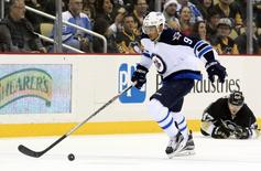 Jan 27, 2015; Pittsburgh, PA, USA; Winnipeg Jets left wing Evander Kane (9) moves the puck up ice against the Pittsburgh Penguins during the first period at the CONSOL Energy Center. Mandatory Credit: Charles LeClaire-USA TODAY Sports
