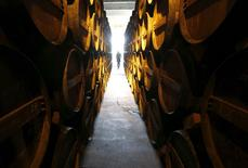 Oak barrels are stored in a cellar where cognac is aged at the distillery of Courvoisier house in Cognac, southwestern France, February 11, 2015. REUTERS/Regis Duvignau