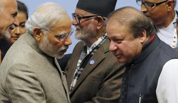 Prime Minister Narendra Modi (L) talks to his Pakistani counterpart Nawaz Sharif (R) during the closing session of 18th South Asian Association for Regional Cooperation (SAARC) summit in Kathmandu November 27, 2014.  REUTERS/Niranjan Shrestha/Pool/Files