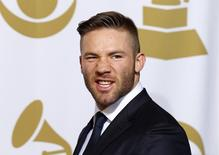 Presenter Julian Edelman, of the New England Patriots, poses in the press room during the 57th annual Grammy Awards in Los Angeles, California February 8, 2015.   REUTERS/Mike Blake