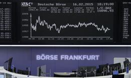 A trader is working at his desk in front of the DAX board at the Frankfurt stock exchange February 16, 2015.  REUTERS/Remote/Pawel Kopczynski