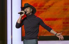 "Singer Tim McGraw performs ""Overrated"" during the taping of ""A Very GRAMMY Christmas"" at the Shrine Auditorium in Los Angeles, California in this November 18, 2014 file photo.  REUTERS/Mario Anzuoni"