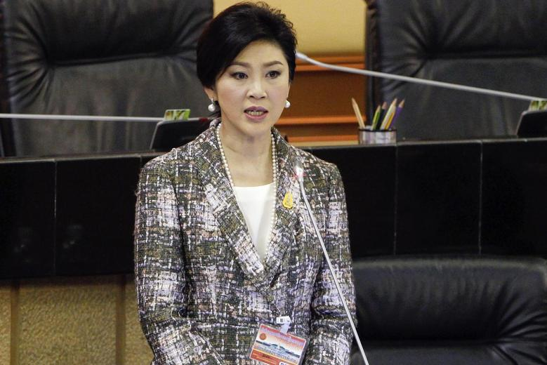 Ousted former Prime Minister Yingluck Shinawatra delivers her statement at the National Legislative Assembly meeting in Bangkok January 22, 2015. REUTERS/Chaiwat Subprasom