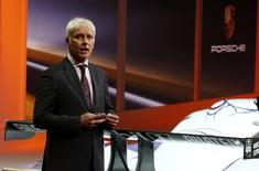 Porsche's CEO Matthias Mueller speaks during a Volkswagen Group Night event ahead of the 84th Geneva Motor Show in Geneva late March 3, 2014. The Geneva Motor Show will run from March 6 to 16. REUTERS/Arnd Wiegmann
