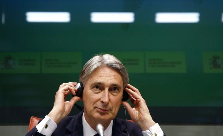 British Foreign Secretary Philip Hammond adjusts his earphones during his joint news conference with Spanish Foreign Minister Jose Manuel Garcia-Margallo (not pictured) at the Foreign Ministry in Madrid February 19, 2015.  REUTERS/Sergio Perez
