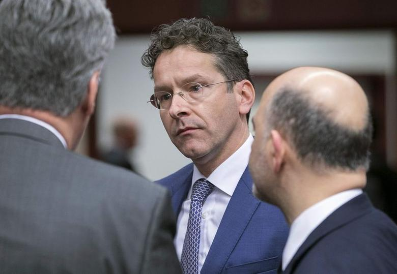 Eurogroup President Jeroen Dijsselbloem (C) takes part in an extraordinary euro zone Finance Ministers meeting (Eurogroup) to discuss Athens' plans to reverse austerity measures agreed as part of its bailout, in Brussels February 20, 2015.  REUTERS/Yves Herman