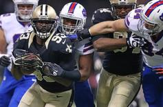 New Orleans Saints outside linebacker Junior Galette (93) is tackled by Buffalo Bills running back Fred Jackson (behind) after recovering a fumble as New Orleans Saints wide receiver Kenny Stills (84) fights off Buffalo Bills tight end Scott Chandler (84) in the first quarter at Mercedes-Benz Superdome. Crystal LoGiudice-USA TODAY Sports