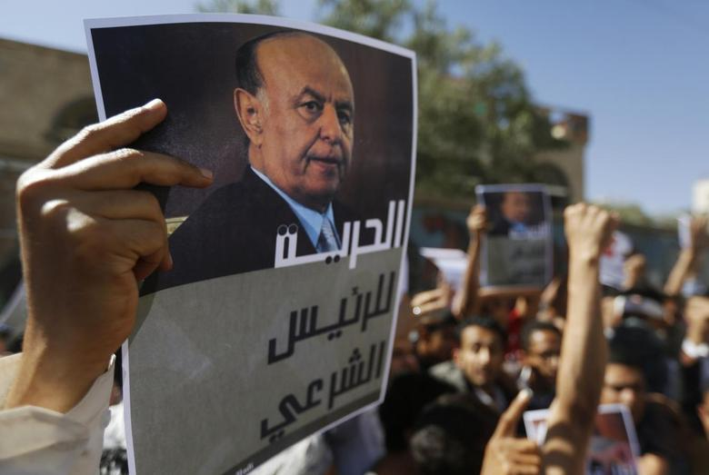 A protester holds up a poster of Abd-Rabbu Mansour Hadi during an anti-Houthi demonstration in Sanaa February 21, 2015.  REUTERS/Khaled Abdullah