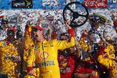 NASCAR Sprint Cup Series driver Joey Logano (22) celebrates winning the Daytona 500 at Daytona International Speedway. Mandatory Credit: Peter Casey