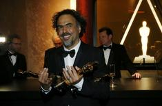 "Director Alejandro Gonzalez Inarritu poses with his Oscars for best picture, best director and best original screenplay for ""Birdman"" after they were engraved at the Governors Ball following the 87th Academy Awards in Hollywood, California February 22, 2015   REUTERS/Mario Anzuoni"