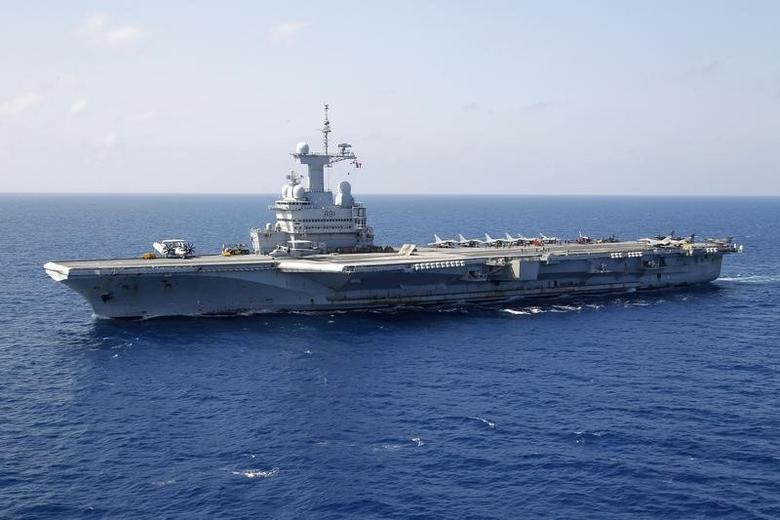 France's flagship Charles de Gaulle aircraft carrier makes it way through the Mediterranean Sea while on mission March 26, 2011. REUTERS/Benoit Tessier
