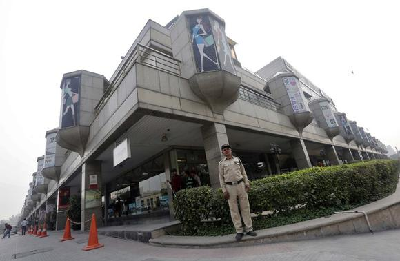 A private security guard stands guard inside the premises of the MGF mall in New Delhi February 23, 2015.  REUTERS/Adnan Abidi