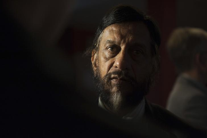 The Intergovernmental Panel on Climate Change (IPCC) Working Group III Chairman Rajendra Pachauri talks to the media after a news conference to present Working Group III's summary for policymakers at the IPCC in Berlin April 13, 2014. REUTERS/Steffi Loos/Files