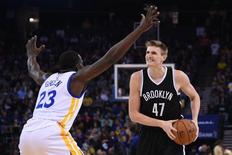 November 13, 2014; Oakland, CA, USA; Brooklyn Nets forward Andrei Kirilenko (47) controls the basketball against Golden State Warriors forward Draymond Green (23) during the first quarter at Oracle Arena. Mandatory Credit: Kyle Terada-USA TODAY