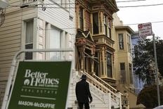 A real state sign is seen near a row of homes in the Haight Ashbury neighborhood in San Francisco, California July 17, 2014. REUTERS/Robert Galbraith