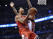 Nov 13, 2014; Toronto, Ontario, CAN;  Chicago Bulls guard Derrick Rose (1) jumps to score against the Toronto Raptors during the first quarter at Air Canada Centre. Mandatory Credit: Peter Llewellyn-USA TODAY Sports - RTR4E3FD