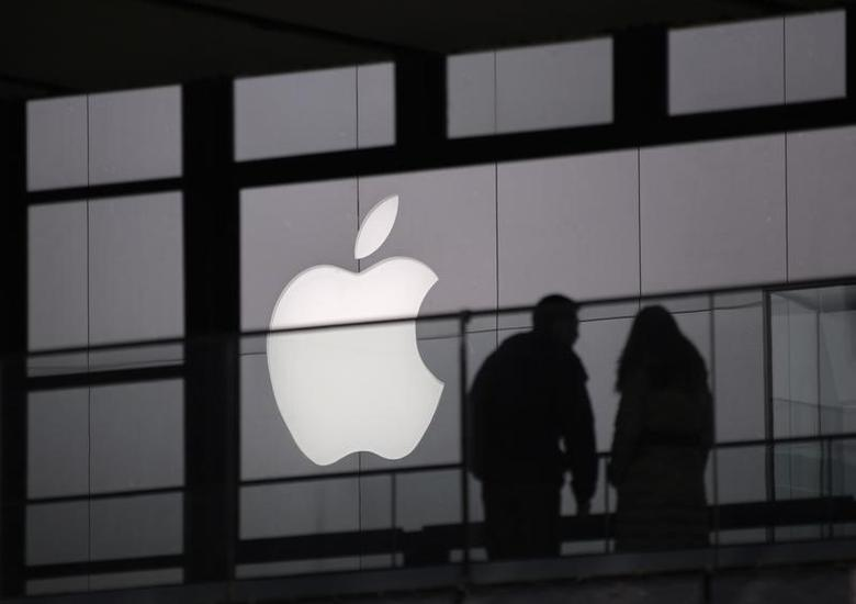 People walk past the Apple logo near an Apple Store at a shopping area in central Beijing February 19, 2013. REUTERS/Petar Kujundzic
