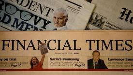 Pearson, propriétaire entre autres du Financial Times, a dégagé des résultats 2014 conformes à ses prévisions et s'est dit optimiste pour cette année après deux ans de restructuration.  /Photo d'archives/REUTERS/Alessia Pierdomenico